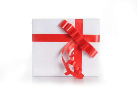White gift box with red tape on white background