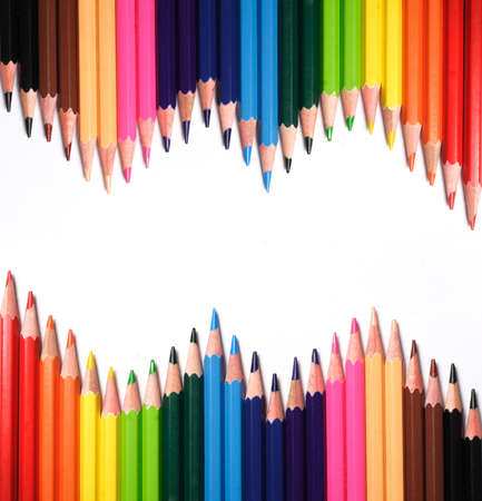 Multi Color pencils on white background photo