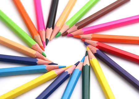 Multi Color pencils on white, circular position  Stock Photo
