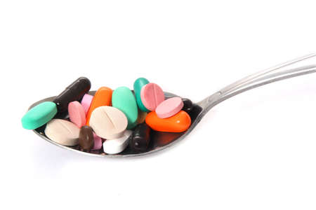 Various pills on the spoon