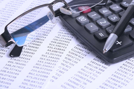 Accounting and Finance, worksheet, pen, calculator and smartphone,  photo