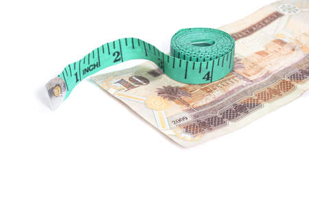 Riyal - Arabic Money and measure tape photo