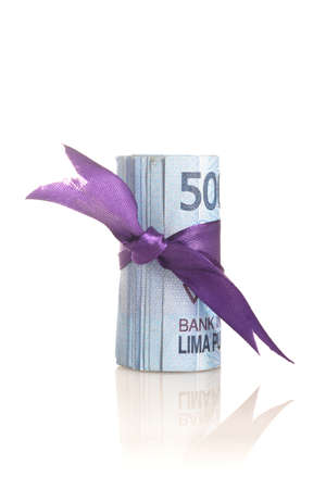 Rupiah - Indonesian Money with purple tape on white Banque d'images