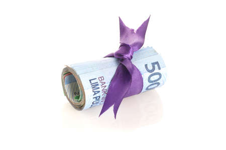 Rupiah - Indonesian Money with purple tape on white Archivio Fotografico