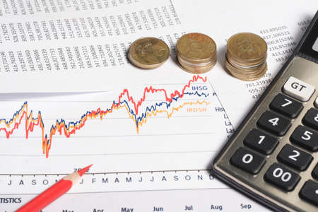 business chart, red pencil, calculator, coins