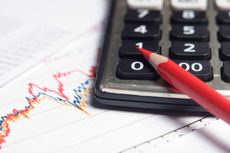 business chart, red pencil, calculator