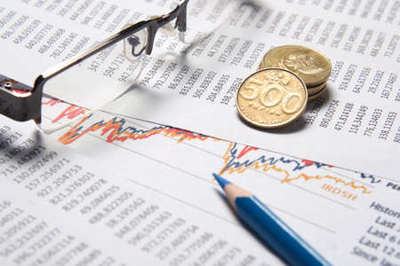business chart, eyeglass, blue pencil, coins Stock Photo
