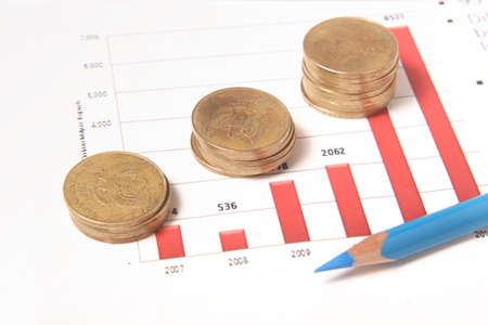 business chart, coins, blue pencil photo