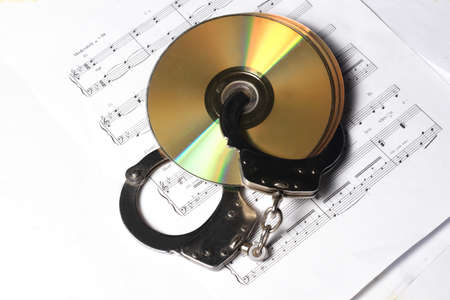 musical concept - CD or DVD with musical note photo