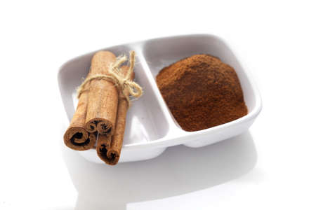 cannelle: Cinnamon over white background Stock Photo