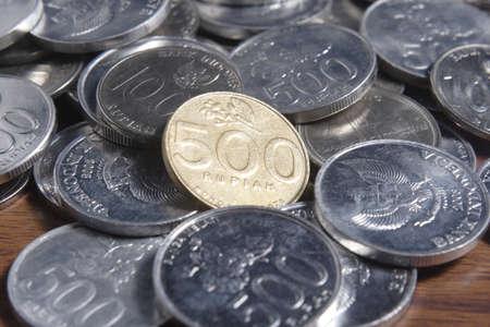 rupiah: coin rupiah at wooden table