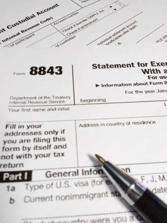close up of USA tax form type 8843, statement for exempt individuals and individuals with a medical condition Banco de Imagens