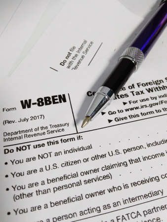 close Up of USA Tax Form type W-8BEN, certificate of foreign status of beneficial owner for united states tax withholding