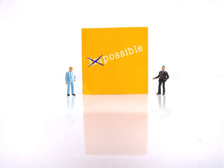 photo two mini figure businessman Explaining change impossible into possible thing 스톡 콘텐츠
