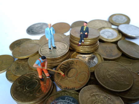 conceptual Illustration for Money Laundry Activity, worker mini figure toy cleaning golden indonesia rupiah coin Stock Illustration - 105073940