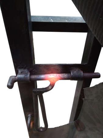 Hot and Burned Corrosive Black Iron Handle of Gate, isolated on white