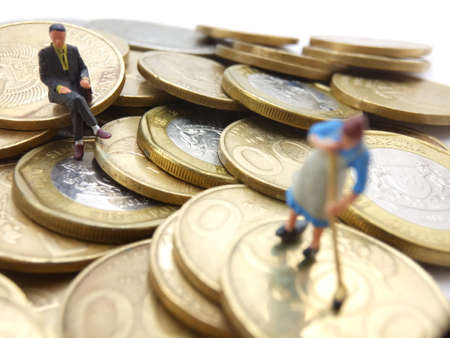conceptual Illustration for Money Laundry Activity, worker mini figure toy cleaning golden indonesia rupiah coin, controlled by her boss