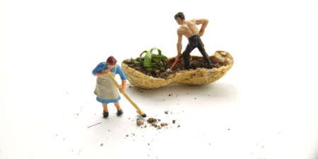 Conceptual Illustration, Keep Struggle, Mini Figure man farming at limited area, peanut skin, with white negative space