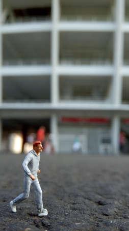 Running Mini Figure man in the morning, at Gelora Bung Karno Stadium Фото со стока
