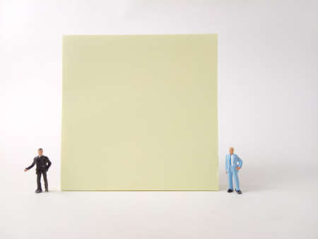 Conceptual, Businessman doing Presentation, near at big blank Yellow paper, at white backround Stock fotó