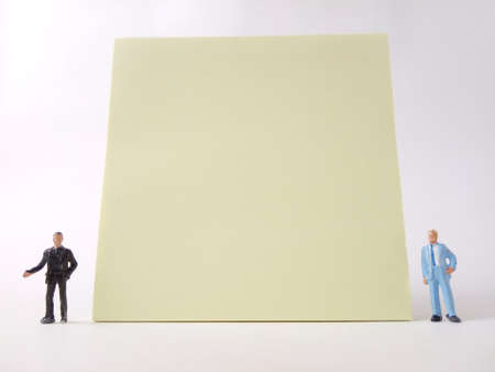 Conceptual, Businessman doing Presentation, near at big blank Yellow paper, at white backround