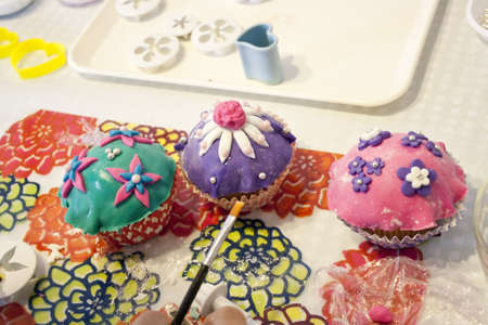 Making of little cakes with coloful design Stock Photo - 9342088