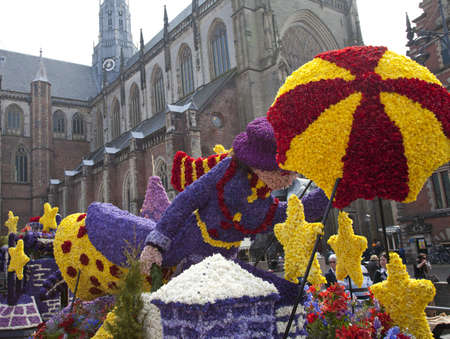 flower parade: HAARLEM, THE NETHERLANDS - APRIL 17 2011: Mary poppins with flowers at flower parade on April 17 2011 in Haarlem, The Netherlands. The annual flower parade is a huge unique flower event with one million visitors.