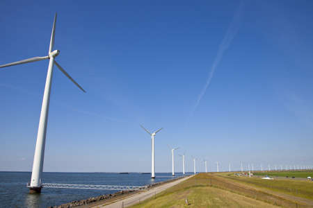 Modern windmills at Dutch dike photo