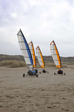 land slide: Sailing buggy at beach with blue sky Stock Photo