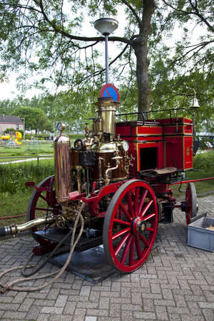 Very old red fire engine on street