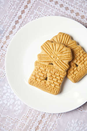 Dutch windmill cookie on dinner plate on table photo