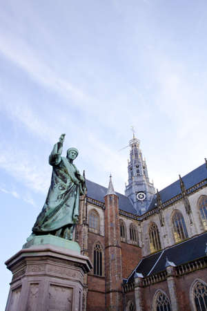 traditionally dutch: Cathedral St. Bavo with statue of printing inventor Laurens Janszoon Coster at big square Haarlem, The Netherlands Editorial