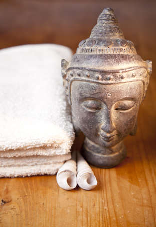 Luxury bath or shower set with towel, buddha and shells on wooden table photo