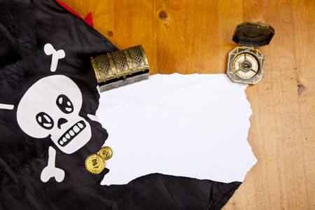 Pirate blank map with treasure, compass and flag with skull photo
