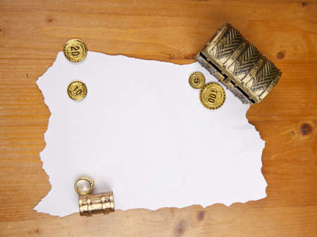 Pirate blank map with treasure, coins and ring photo