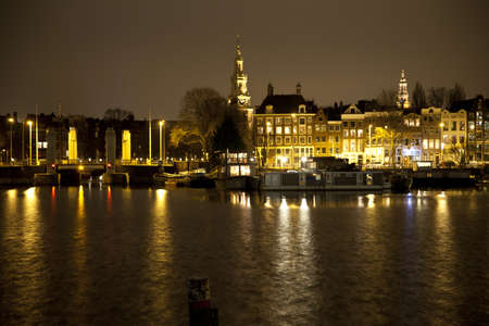 View at Amsterdam at night with canal and historic buildings