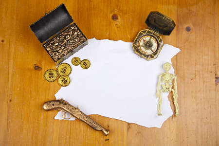 Pirate blank map with treasure, coins, skeleton and compass photo