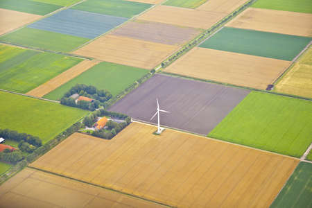 netherlands: Farm landscape with windmill  from above, The Netherlands Stock Photo
