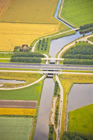 Dutch farm landscape with infrastructure road and canal photo