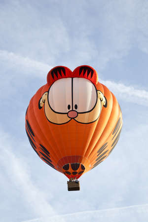 BARNEVELD, THE NETHERLANDS - 17 AUGUST 2012: Colorful Garfield balloon taking off at international balloon festival Ballonfiesta in Barneveld on August 17 in Barneveld, The Netherlands  Editorial