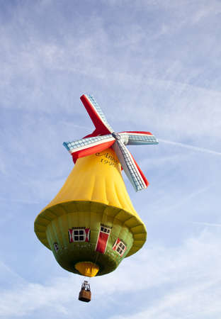 BARNEVELD, THE NETHERLANDS - 17 AUGUST 2012: Colorful wind mill balloon taking off at international balloon festival Ballonfiesta in Barneveld on August 17 in Barneveld, The Netherlands  Editorial