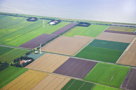 Farm landscape with windmill  from above, The Netherlands Stock Photo
