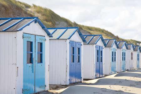 Dutch little houses on beach in De Koog Texel, The Netherlands Stock Photo