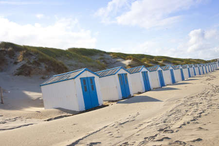 texel: Dutch little houses on beach in De Koog Texel, The Netherlands Stock Photo