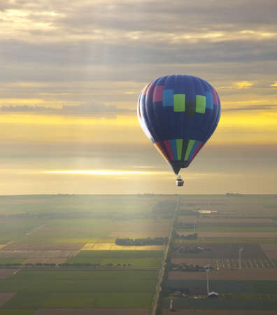 Hot air balloon with beautiful sunset sky photo