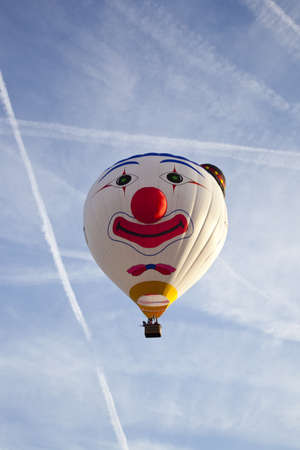 BARNEVELD, THE NETHERLANDS - 17 AUGUST 2012: Colorful clown balloon taking off at international balloon festival Ballonfiesta in Barneveld on August 17 in Barneveld, The Netherlands  Stock Photo - 15927931