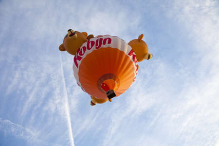 BARNEVELD, THE NETHERLANDS - 17 AUGUST 2012: Colorful bear balloon taking off at international balloon festival Ballonfiesta in Barneveld on August 17 in Barneveld, The Netherlands  Stock Photo - 16019783