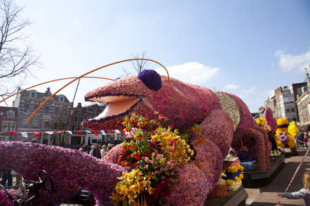 HAARLEM, THE NETHERLANDS - APRIL 21 2013: Pink lobster with flowers at flower parade on April 21 2013 in Haarlem, The Netherlands. The annual flower parade is a unique event with one million visitors.  Stock Photo - 19213405
