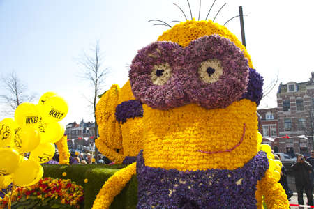 HAARLEM, THE NETHERLANDS - APRIL 21 2013: Despicable character with flowers at flower parade on April 21 2013 in Haarlem, The Netherlands. The annual flower parade is a unique event with one million visitors.  Stock Photo - 19213404