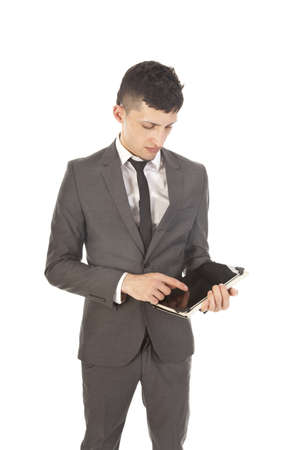 Young man holding a black tablet isolated on white photo